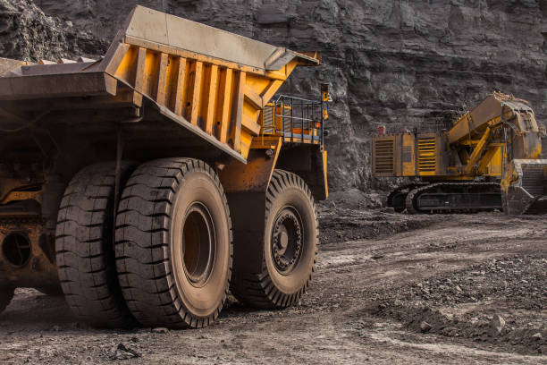 quarry dump trucks in coal mining quarry dump trucks in coal mining mining natural resources stock pictures, royalty-free photos & images