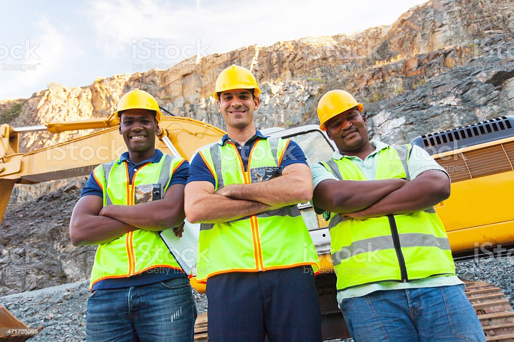 quarry workers standing with arms crossed stock photo