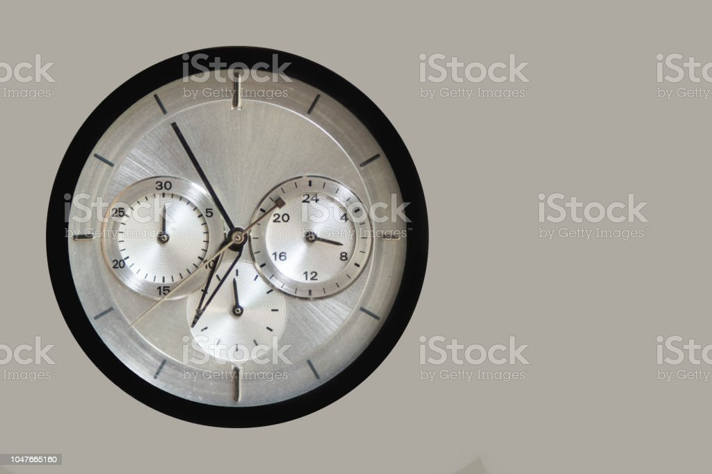 Quartz clock with chronograph on grey background stock photo
