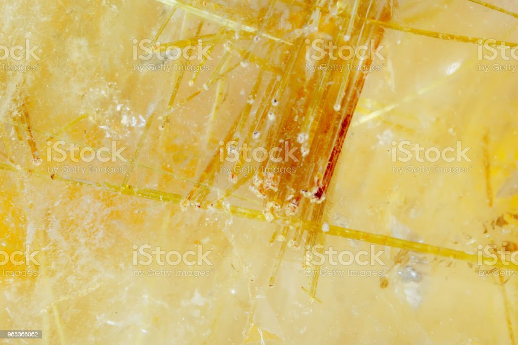 Quartz hairy. The texture of the mineral. Macro shooting of natural gemstone. The raw mineral. Abstract background royalty-free stock photo
