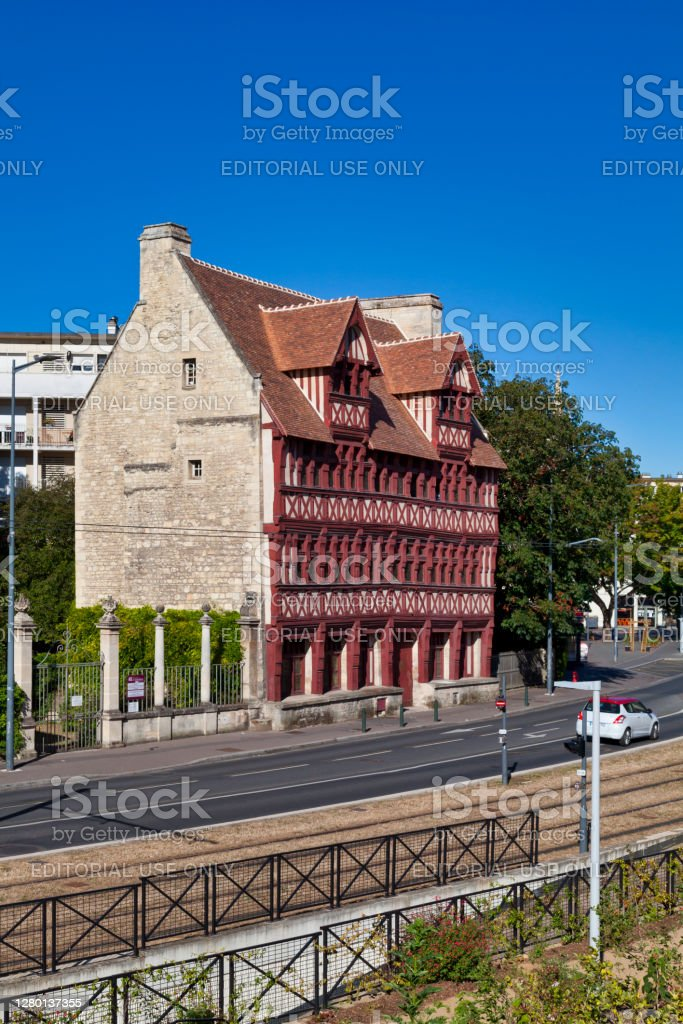 Quatrans house in Caen Caen, France -  August 06 2020: The Quatrans house (French: Maison des Quatrans) is a half-timbered house built in the 1460s in the old city center of Caen. The entire old Quatrans hotel has been classified as a historical monument since July 24, 1953. Architecture Stock Photo