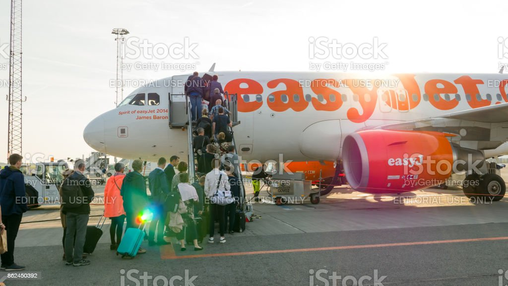 Que of passengers of EasyJet airline boarding to the plane stock photo