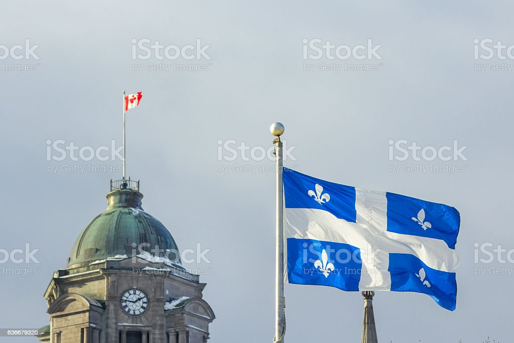 Quebec and Canadian flags in Quebec City, QC, Canada stock photo