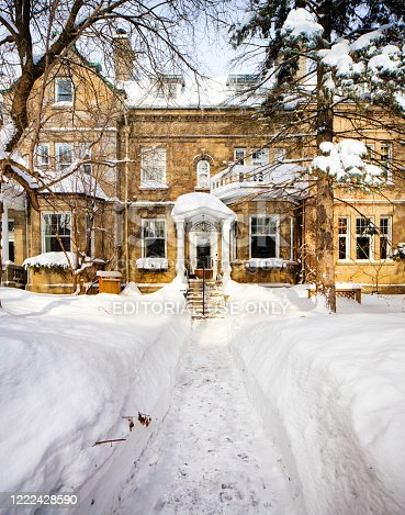 Quebec City House in Winter with a shovel path leading to the front door.