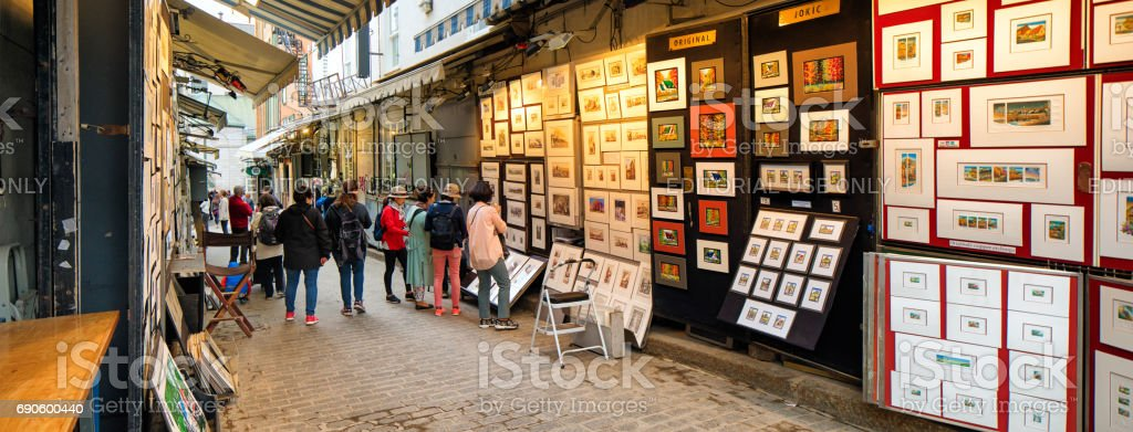 Quebec City rue du tresor art booths with visitors panorama stock photo