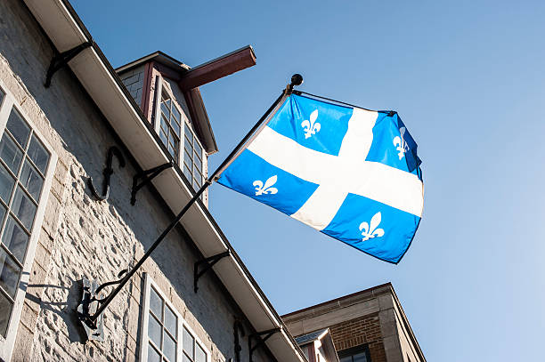 Quebec Flag on Old Building, Quebec City, Canada. stock photo