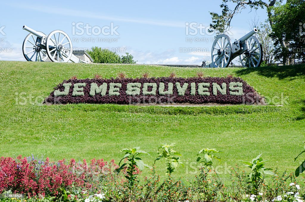 Quebec motto in grass with cannon and Frontenac castle stock photo
