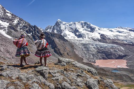istock Quechua girls admire Andean mountain views on the Ausangate trail. Cusco, Peru 1216298852