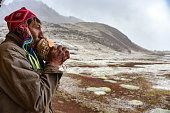 istock A Quechua man blows on a Conch shell in the Andes mountains near Cusco, Peru 1216305108