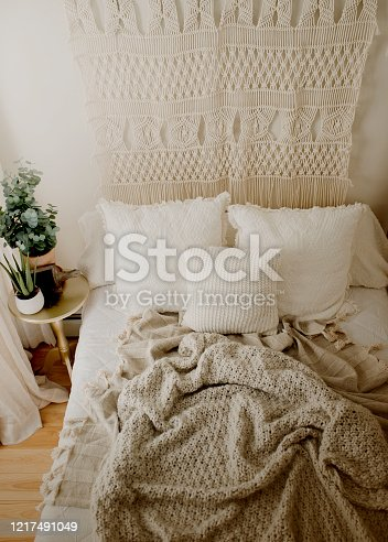 Queen Bed Layered with Neutral Duvet and Comfy Throw Blankets