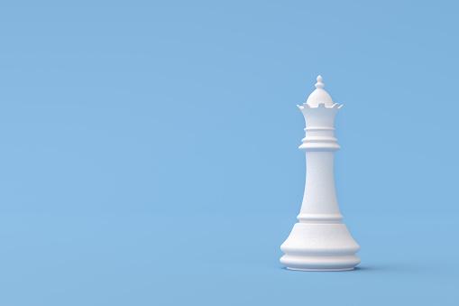 Plaster Queen Chess Piece on blue background