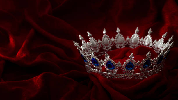 queen coronation in fairy tales and legends monarchy and royal jewels concept with close up on a sparkling silver crown or tiara on low key dark red velvet background with copyspace - diadem stock pictures, royalty-free photos & images