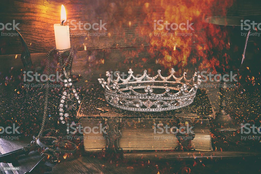 queen crown on old book. fantasy middle age concept stock photo
