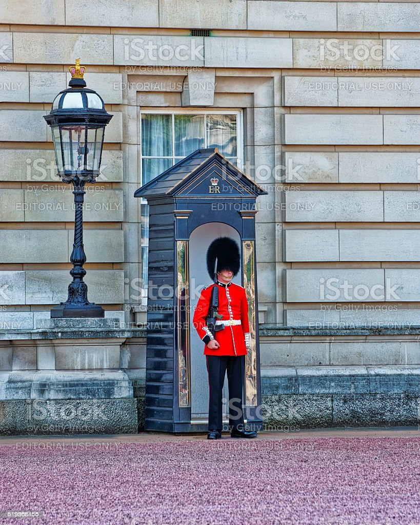 Queen Guard at his post at Buckingham Palace in London stock photo