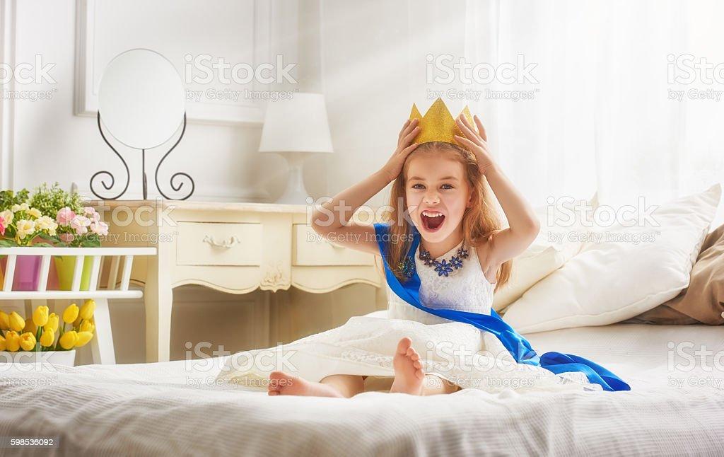 queen in gold crown stock photo