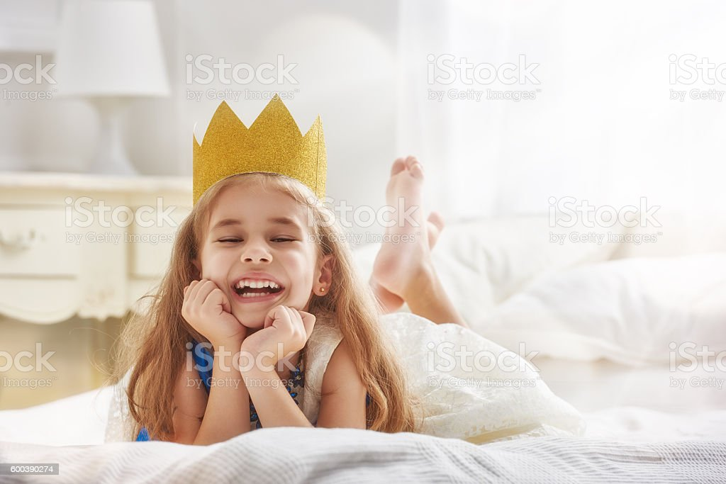 queen in gold crown stock photo