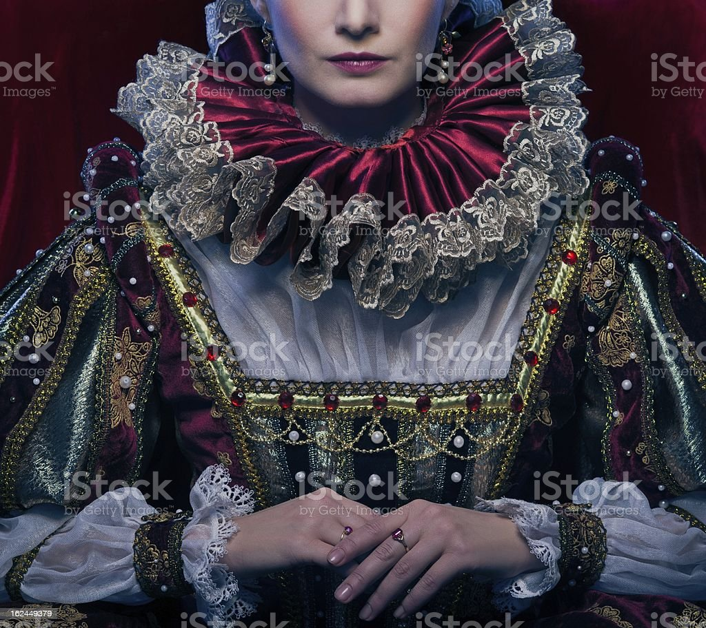 Queen in royal dress and luxuriant collar stock photo
