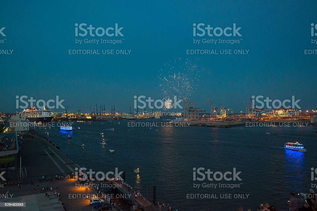 Queen Mary 2 luxurious cruise liner and fireworks stock photo