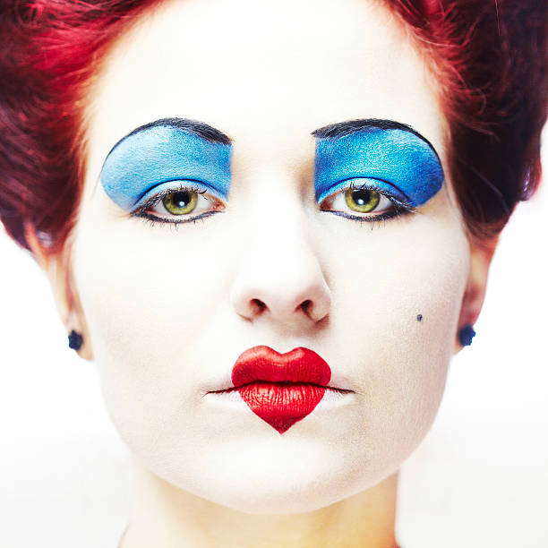 Queen of hearts makeup on a woman stock photo
