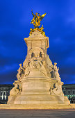 istock Queen Victoria memorial at Buckingham palace at night, London, UK 1290020219