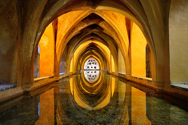 Queen's baths, Alcazar of Seville Queen's baths in the Royal Alcazar of Seville, Spain. UNESCO World Heritage Site alcazar palace stock pictures, royalty-free photos & images