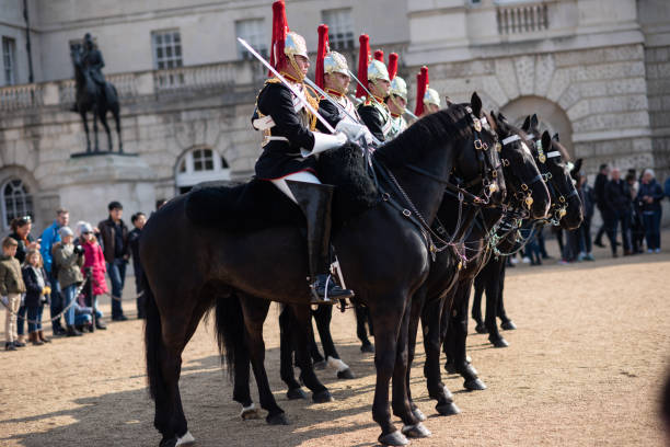 Queen's Guard March on Horses in the Streets of London, United Kingdom stock photo