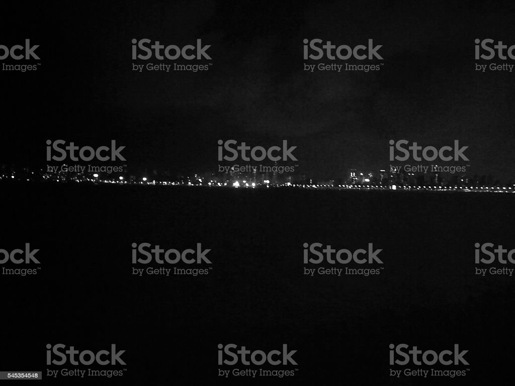 Queen's necklace Queen's Necklace is an alternate name for Marine Drive in Mumbai which at night looks like a necklace because of all the street lights. Black And White Stock Photo