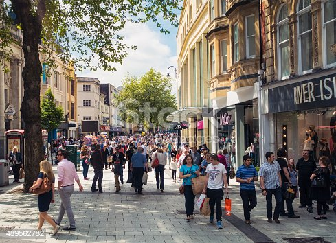 Queen Street, one of Cardiff's main shopping streets, busy with Saturday shoppers.