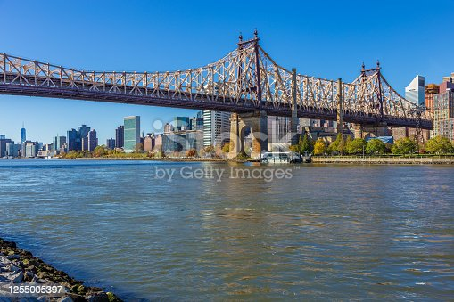 Queensboro Bridge and Manhattan Skyline with UN Building, World Trade Center and Water of East River lit by the morning sun, as seen from Queens, New York, USA. Canon EOS 6D (full frame sensor) DSLR and Canon EF 24-105mm F/4L IS lens. HDR image.