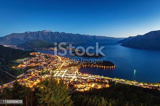 Scenic view to the City of Queenstown in the South-West of the south island of New Zealand at Twilight - Night. Queenstown, Otago, South Island, New Zealand, Oceania.