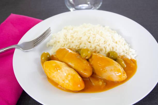 quenelles de veau et riz quenelles de veau et riz sauce financière riz stock pictures, royalty-free photos & images