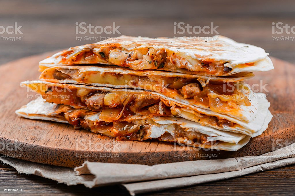 Quesadilla on a wooden table stock photo