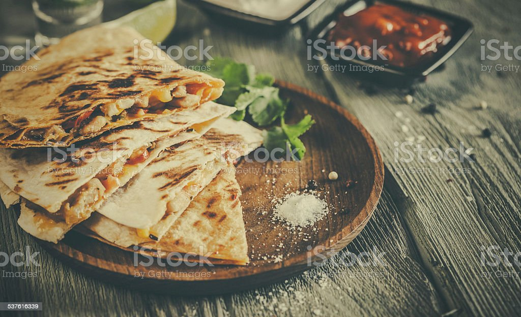 Quesadilla on aged wooden table stock photo
