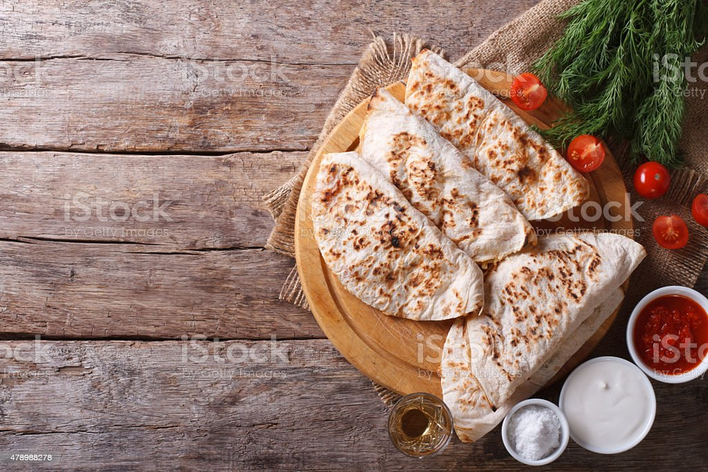 Quesadilla with sour cream and tomato sauce horizontal top view stock photo