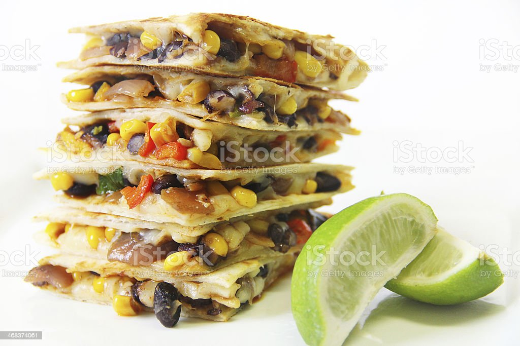 quesadillas stacked with lime stock photo