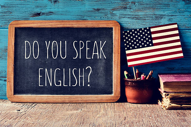 question do you speak english? in a chalkboard - langue anglaise photos et images de collection