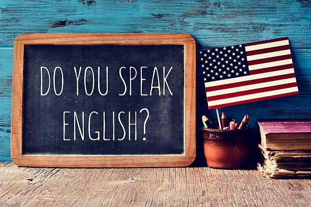 question do you speak english? in a chalkboard - english foto e immagini stock