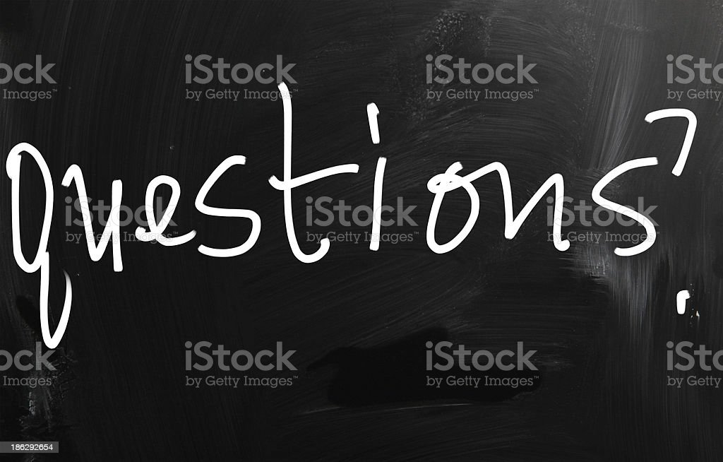 'Question' handwritten with white chalk on a blackboard royalty-free stock photo