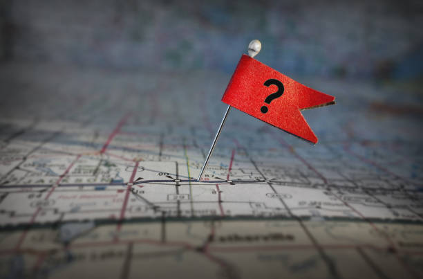 question mark flag on a map stock photo