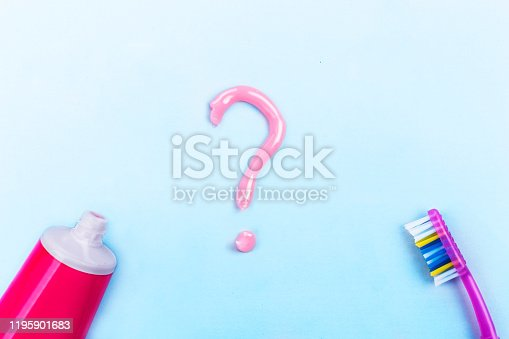 istock Question mark from toothpaste on blue background, toothpaste selection concept 1195901683