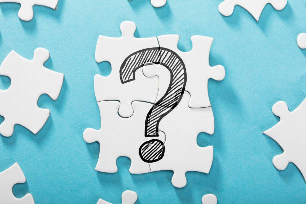 Question Mark Icon On White Puzzle stock photo