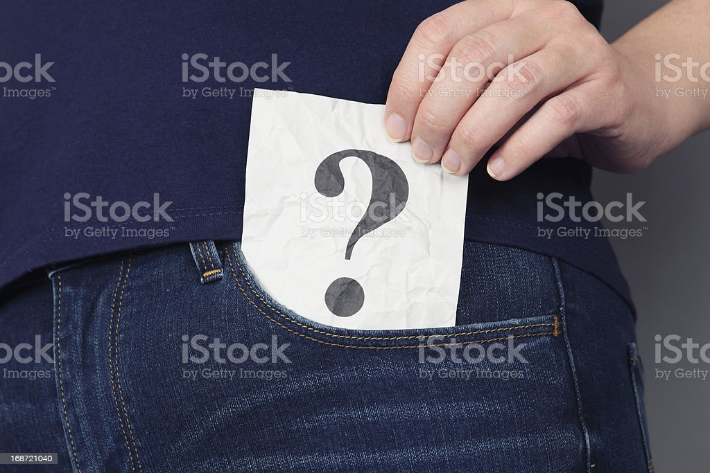 Question mark in pocket of jeans royalty-free stock photo
