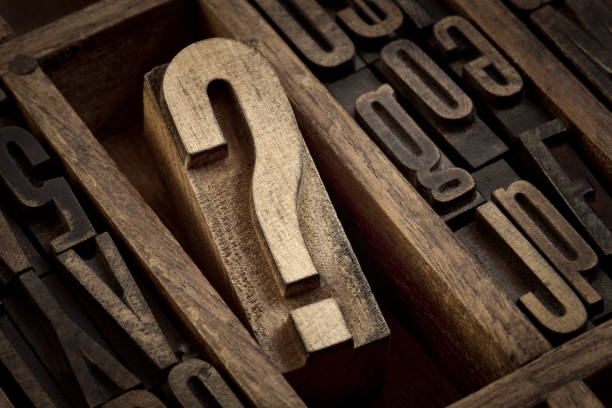 question mark in vintage letterpress type - letterpress stock photos and pictures