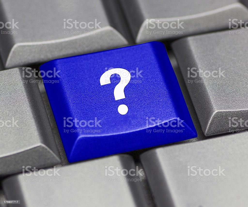 Question mark on a blue computer key stock photo