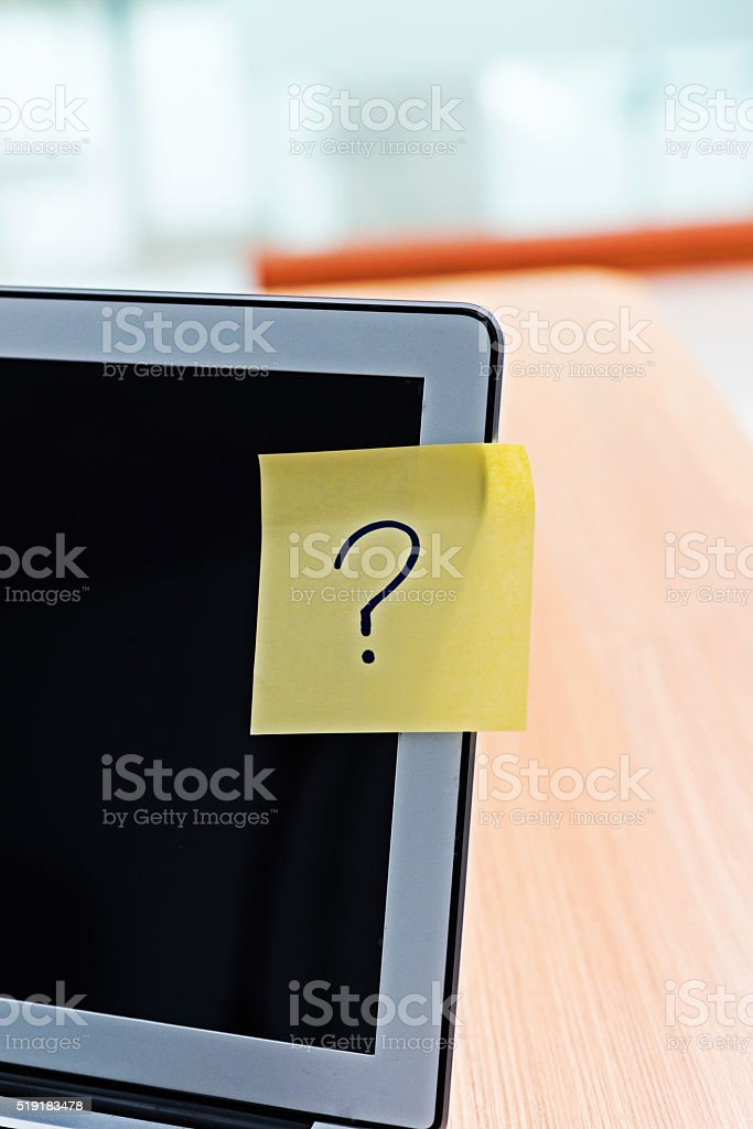 Question mark on laptop stock photo