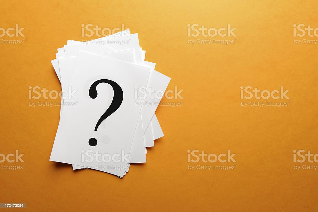 Question mark on paper stock photo