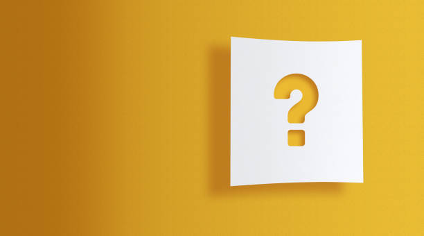 question mark on white information paper on yellow background stock photo