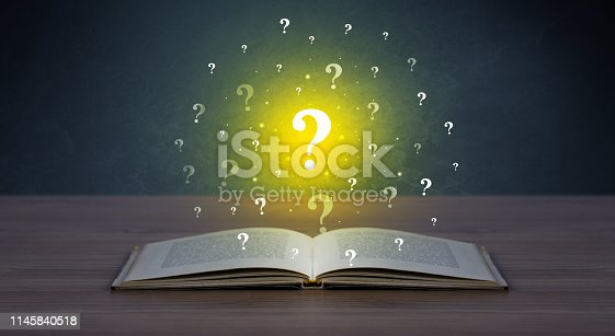 istock Question marks over book 1145840518