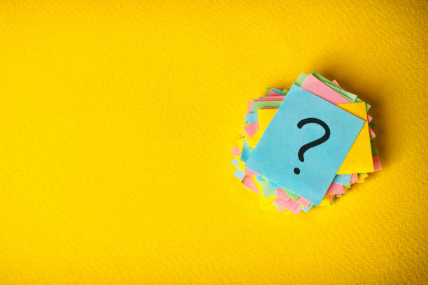 question marks written reminders tickets on yellow vintage paper background stock photo