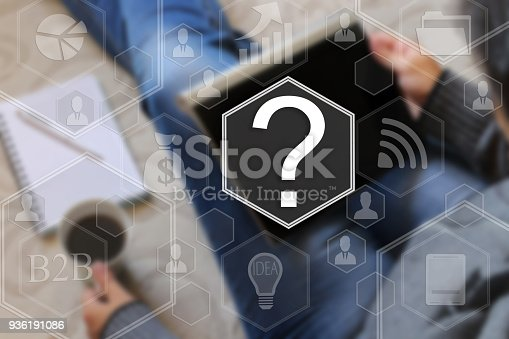 istock Question on the touch screen with a blur the girl with the gadget, background .The concept of question, searching the network 936191086